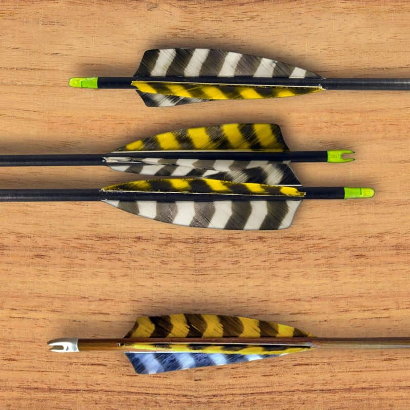 Arrows for a traditional bow on a wood table