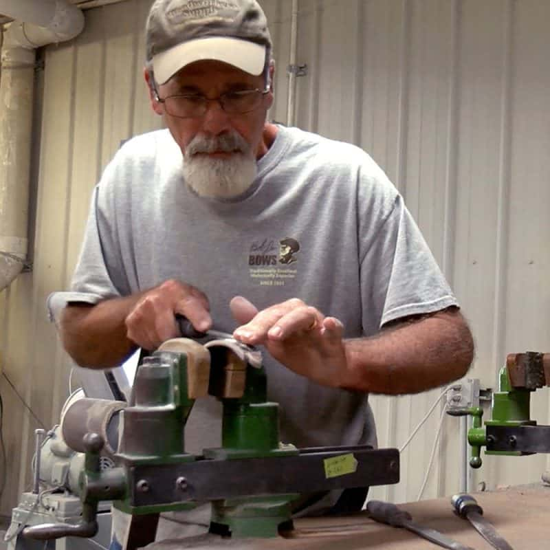 Rob Lee handcrafting the string groove of a traditional takedown bow
