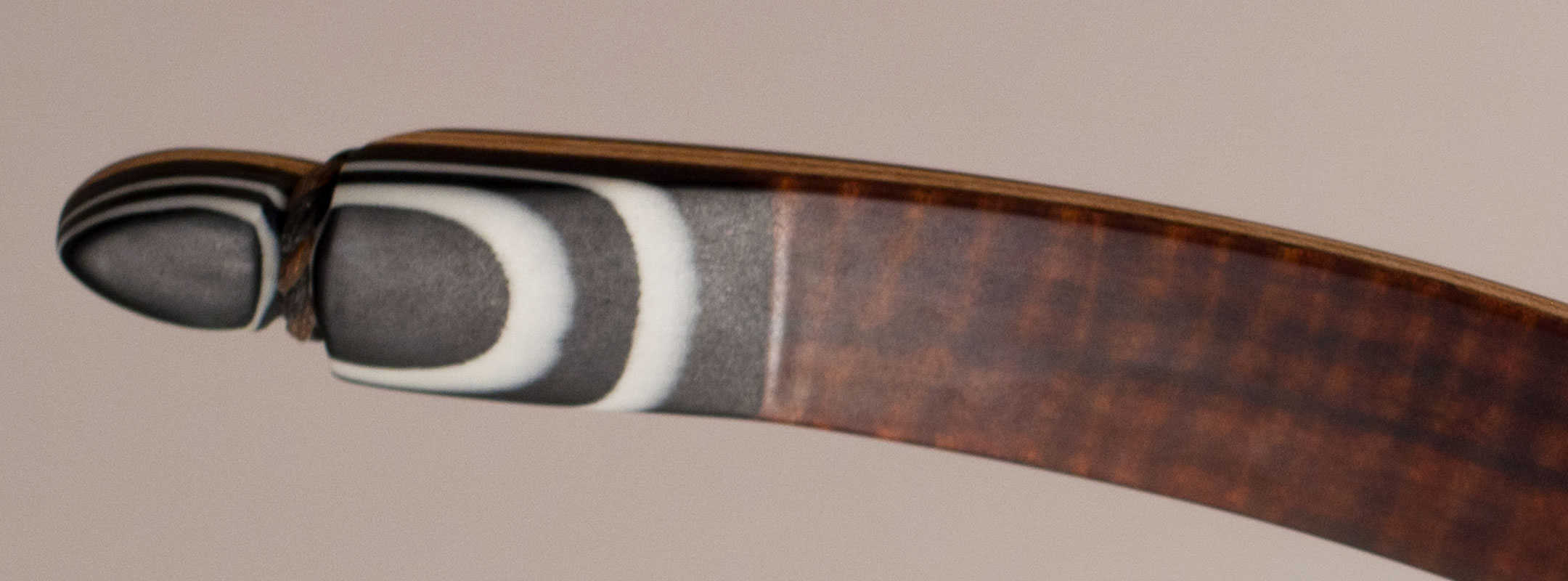 Longbow limb tip in white and black with bow string groove