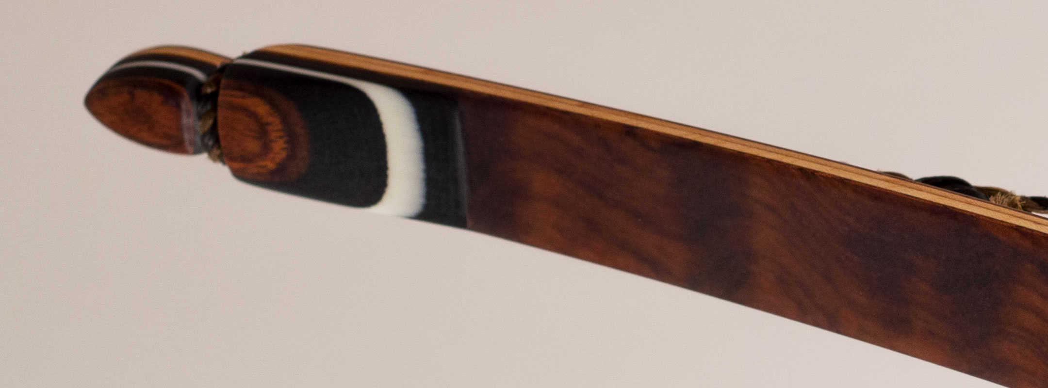 Limb tip of a traditional longbow with reflex and deflex